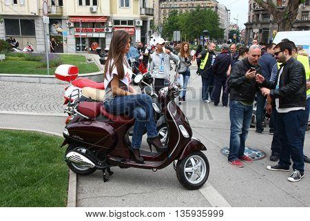BELGRADE SERBIA-JUN 11, 2011Model pose at traditional manifestation, Vespa meeting