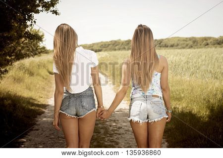 girlsfiends holding hands on a sunny day