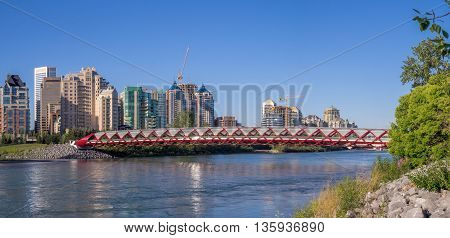 CALGARY, CANADA - JUNE 5: The Peace Bridge spanning the Bow River on June 5, 2016 in Calgary, Alberta. The Peace Bridge was designed by celebrity architect Santiago Calatrava.