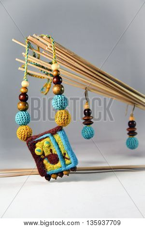 Necklace and earrings made of felt and wooden beads in ethnic style