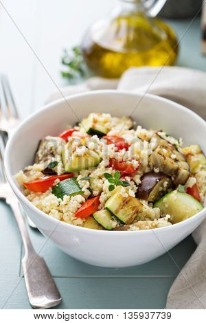 Warm couscous salad with grilled vegetables and thyme