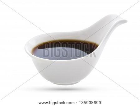 Bowl with soy sauce isolated on white background.