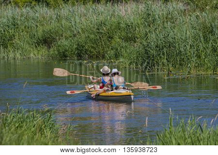 Two people canoeing float peaceful natural river