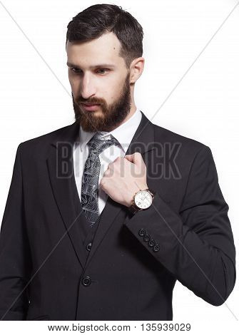 Close up portrait of a young bearded businessman on white background