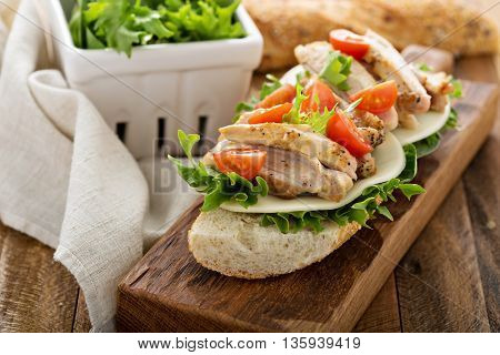 Grilled chicken sandwich with basil, cheese and tomatoes