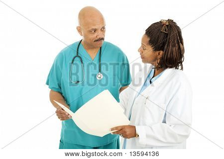 Attractive african-american medical doctors read a patient's chart.  Isolated on white.