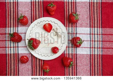 Red Fresh Strawberries on the Ceramic White Plate on the Check Tablecloth.Breakfast Organic Healthy Tasty Food.Wish Card.Cooking Vitamins Ingredients.Summer Fruits.Top View