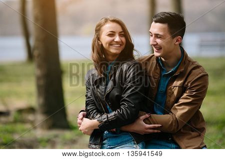 Beautiful young couple relaxing in the park
