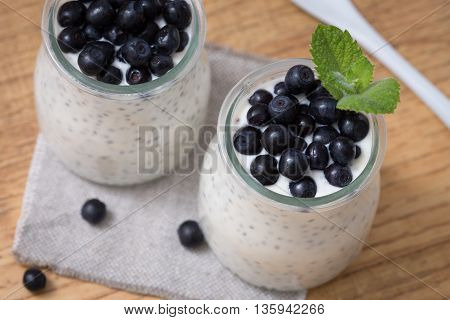 Healthy breakfast or morning snack with chia seeds vanilla pudding and blueberries. vegetarian food diet and health concept.