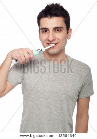 man brushing his teet