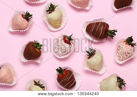 Strawberries Covered In Chocolate On A Pink Background