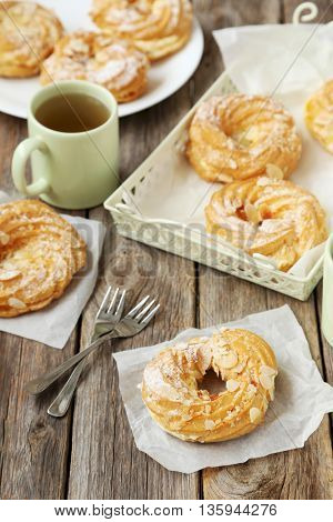 Sweet Eclairs On A Grey Wooden Table