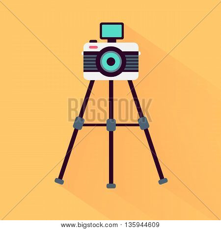 Modern hipster styled photo camera on a tripod yellow background flat and shadow theme design