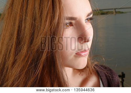 Portrait of beautiful pensive girl with red hair looking away instagram effect.