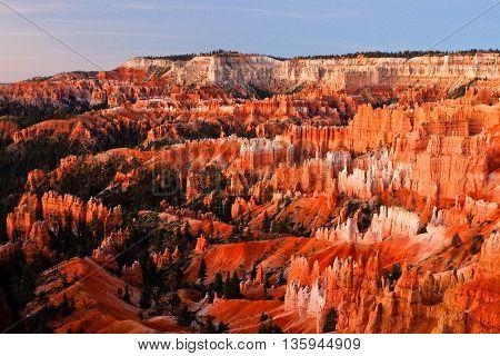 Sunrise Illuminates Bryce Canyon.  Bryce Canyon National Park, Utah, USA