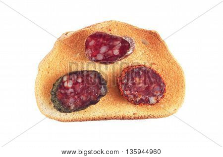 Sandwich with various sliced salami and toasted bread isolated on white background top view