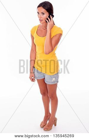 Thinking Young Brunette With Cell Phone