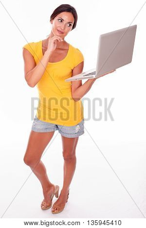 Smiling Young Brunette With A Laptop