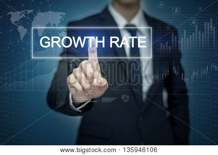 Businessman hand touching GROWTH RATE button on virtual screen