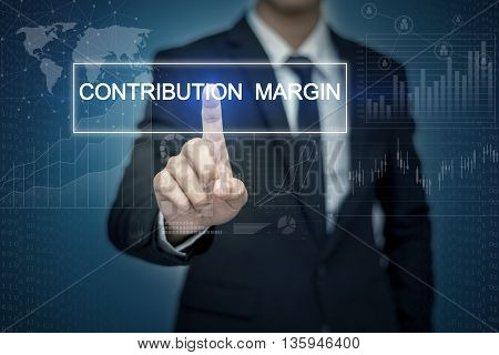 Businessman hand touching CONTRIBUTION MARGIN button on virtual screen