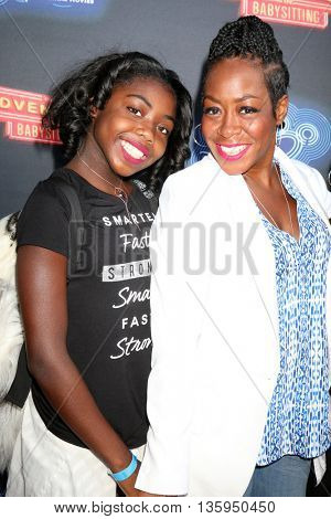LOS ANGELES - JUN 23:  Alijah Kai Haggins, Tichina Arnold at the 100th DCOM Adventures In Babysitting LA Premiere Screening at the Directors Guild of America on June 23, 2016 in Los Angeles, CA