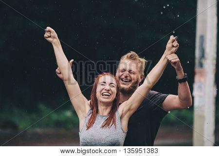 beautiful couple enjoying life on the background of a rainy day