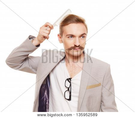 Young man comb his hair isolated at white. Handsome guy with mustache brushing, care himself. Stylish boy, male beauty and hairstyle. Nice looking cute hairdresser