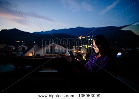 Woman Using Smartphone At Night