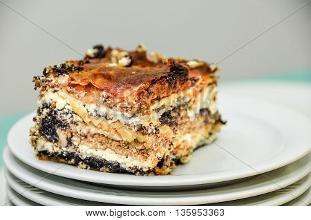Traditional dish from Slovenia dessert mad of layers of fresh cheese walnuts poppy seeds and other goodies