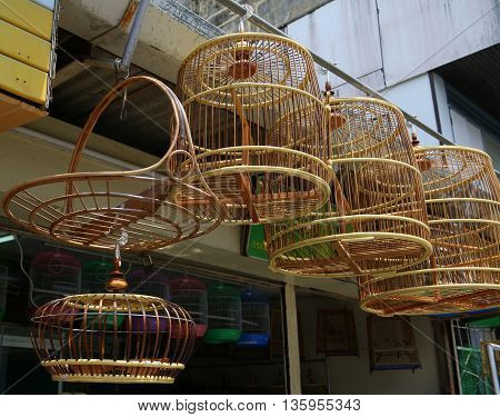 traditional Thai handmade bamboo bird cages hanging in Songkhla pet shop, Thailand