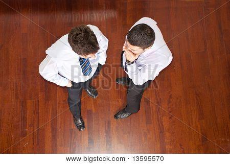 Top View Of Business Men Telling Secret