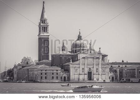 View at old basilica San Giorgio Maggiore in small island in Venice, black and white view.