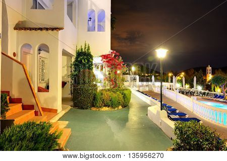Swimming pool at the luxury hotel in night illumination Mallorca island Spain