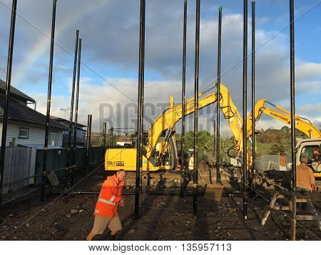 AUCKLAND JUN. 16: Construction workers setting up building foundation at project construction work site in Auckland New Zealand taken on June 16 2016.