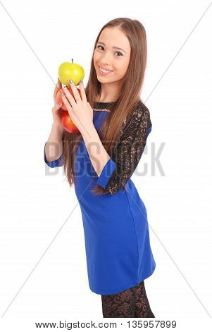 Young smiling brunette girl holding three apples isolated on white