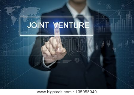 Businessman hand touching JOINT VENTURE button on virtual screen
