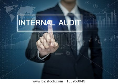 Businessman hand touching INTERNAL AUDIT button on virtual screen