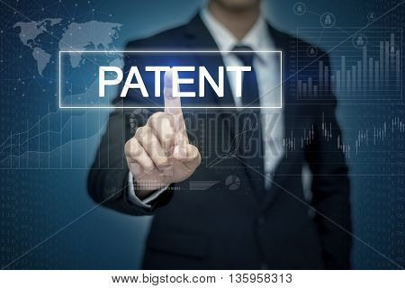 Businessman hand touching PATENT button on virtual screen