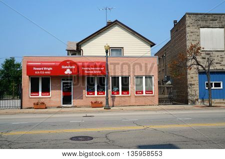 JOLIET, ILLINOIS / UNITED STATES - JUNE 30, 2015: One may purchase insurance at Howard Wright's State Farm insurance agency in downtown Joliet.