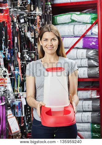 Female Customer Holding Pet Food Bowl At Store