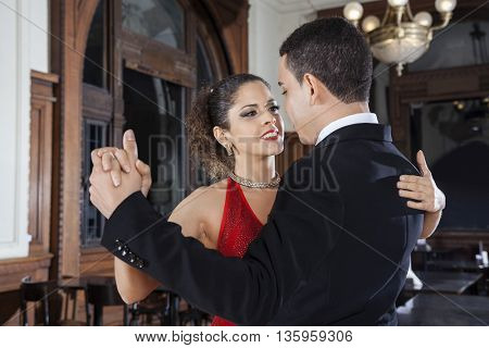 Tango Dancer And Young Man Performing Gentle Embrace