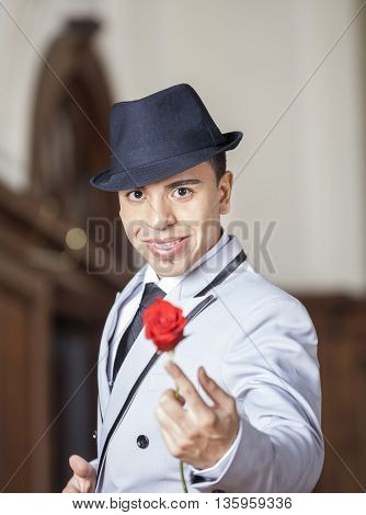 Tango Dancer Holding Rose While Performing In Restaurant
