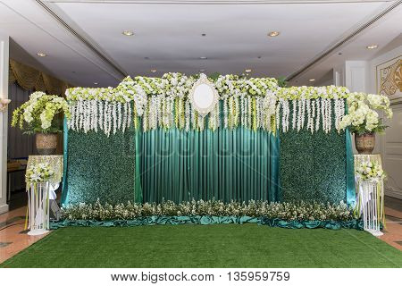 green wedding backdrop with white rose flower