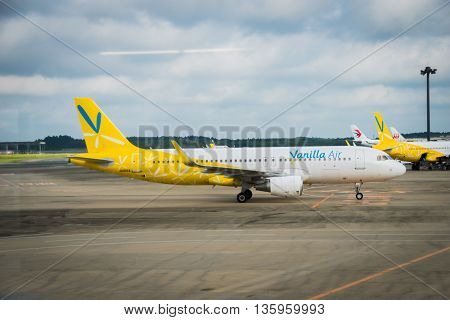 TOKYO, JAPAN - circa JUNE 2016: Vanilla Air  Aircraft towed at Narita International Airport, Japan. Vanilla Air is a low-cost airline newly founded in Japan and wholly owned by All Nippon Airways.