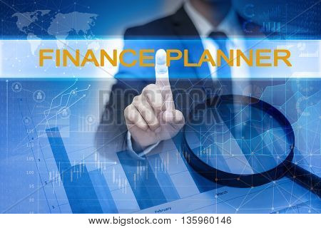 Businessman hand touching FINANCE PLANNER button on virtual screen