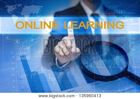 Businessman hand touching ONLINE LEARNING button on virtual screen