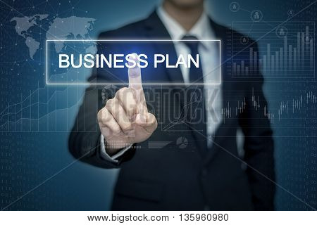 Businessman hand touching BUSINESS PLAN button on virtual screen