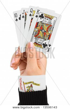 Hand and joker in sleeve