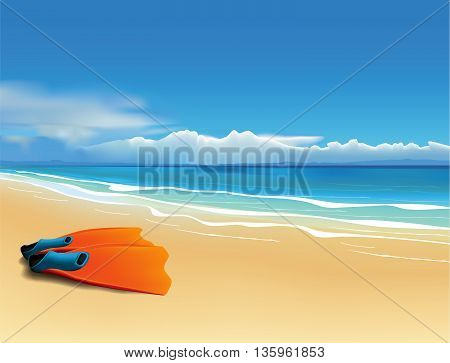 Pair of orange fins on the beautiful beach.
