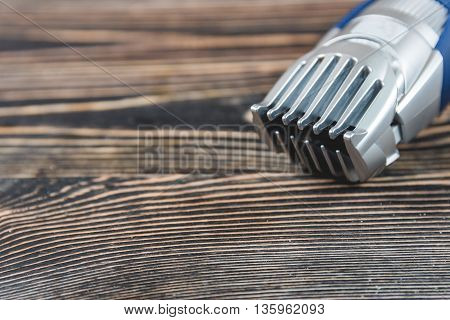 Electric Razor, Hair Trimmer on a Wooden Table, Care Concept